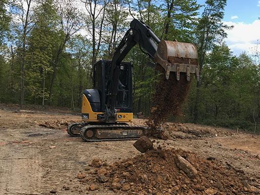 Bulldozer digging dirt.